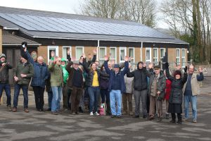 school solar array and DCE members