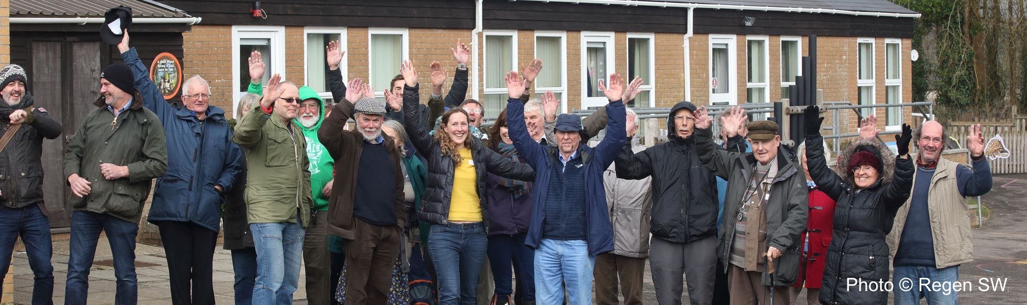Members waving in front of Greenford School