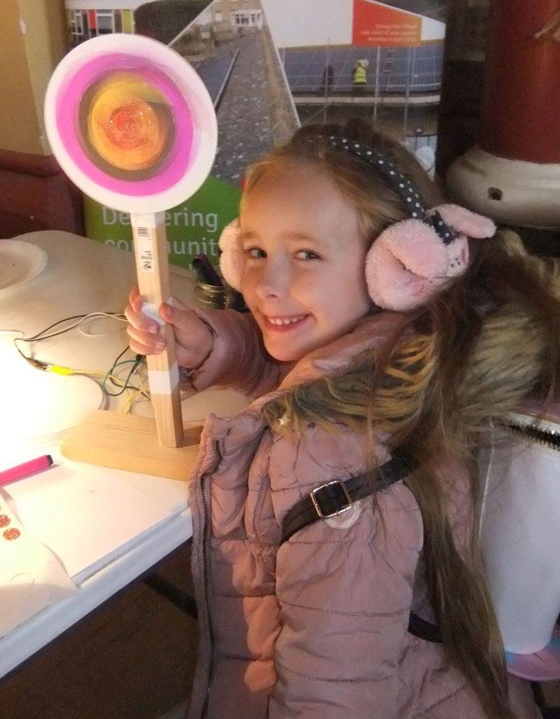 girl with miniature wind turbine
