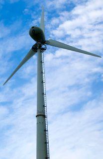 Wind turbine blue sky clouds